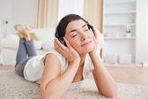 Serene woman listening to music — Stock Photo
