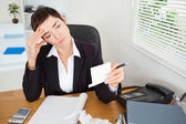 Unhappy accountant checking receipts — Stock Photo