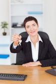 Secretary showing keys — Stock Photo
