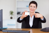 Secrertary showing a blank business card — Stock Photo