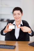 Portrait of a secrertary showing a blank business card — Stock Photo