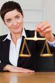Woman holding the justice scale — Stock Photo