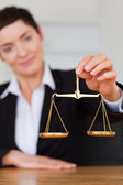 Serious woman holding the justice scale — Stock Photo