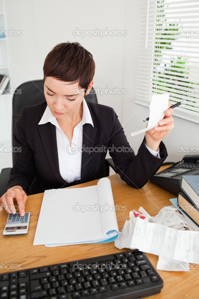Portrait of an active accountant checking receipts in her office — Stock Photo #11178653