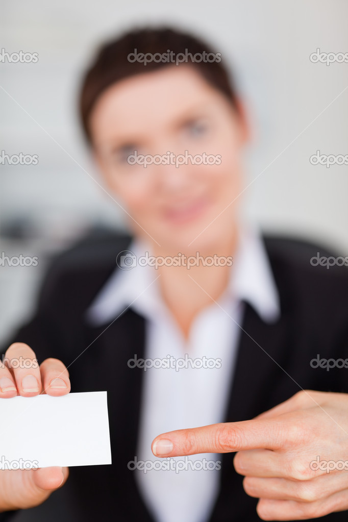 Portrait of a woman showing a blank business card with the camera focus on the object — Stock Photo #11178732