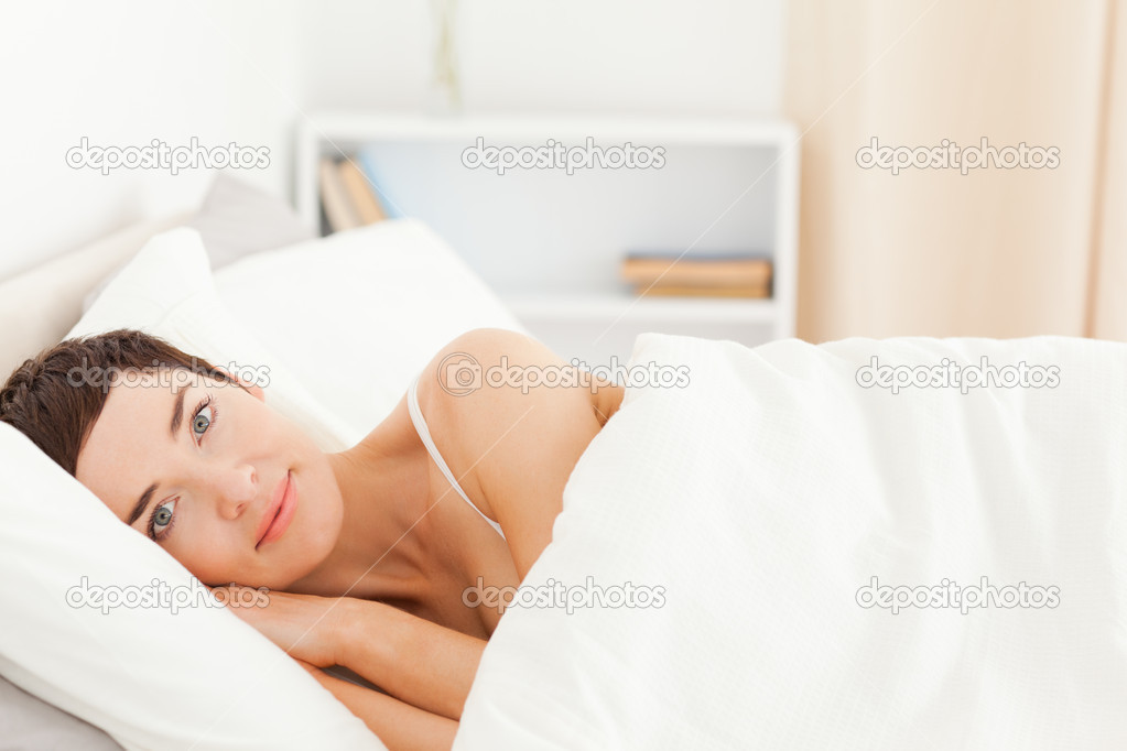 Cute woman waking up in her bedroom — Stock Photo #11178871