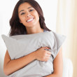Woman with pillow in her arms — Stock Photo #11180040
