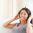 Cute woman with earphones and closed eyes — Stock Photo #11180403