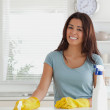 Stock Photo: Pretty womdoing housework