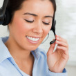 Portrait of a charming woman with a headset helping customers wh - Stock Photo