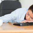 Frontal view of a good looking woman sleeping on a keyboard whil — Stock Photo