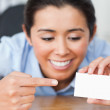 Beautiful woman showing her visiting card — Stock Photo