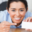Stock Photo: Attractive womshowing her visiting card