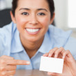 Stock Photo: Charming womshowing her visiting card