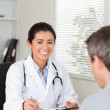 Royalty-Free Stock Photo: Patient giving his good looking woman doctor a piece of paper