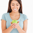 Gorgeous woman holding a green apple — Photo