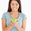 Pretty woman holding a green apple — Stock Photo