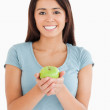 Lovely woman holding a green apple — Stock Photo