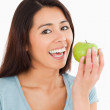 Beautiful woman eating a green apple — Stock Photo