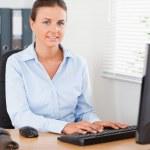 Smiling businesswoman working — Stock Photo