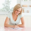 Smiling woman proof-reading a text — Stock Photo #11181631