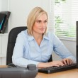 Working woman in front of a screen — Stock Photo