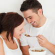 Royalty-Free Stock Photo: Portrait of a man feeding cereal to his wife