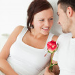 Close up of a Cheerful couple with a rose — Stock Photo