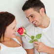 Portait of man and woman in a bed with a rose — Stock Photo #11182375