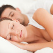 Sleeping couple lying in their bed — Stock Photo