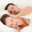 Woman not wanting to hear snoring — Stock Photo