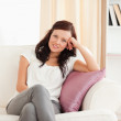 Portrait of a posing woman on a sofa — Stock Photo #11182545