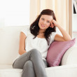 Portrait of a cute posing woman on a sofa — Stock Photo