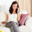 Womon phone with magazine on her lap — Stock Photo #11182584
