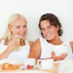 Portrait of a beautiful couple having breakfast — Stock Photo