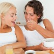 Happy couple eating breakfast — Stock Photo #11183436