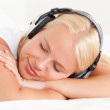 Close up of a quiet woman enjoying some music — Stock Photo #11183755