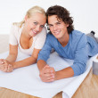 Close up of a couple with a plan and cups of coffee — Stock Photo