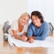 Portrait of a happy couple organizing their new home — Stock Photo #11183948