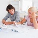 Stressed couple doing accounts — Stock Photo #11184371