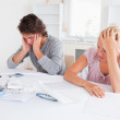 Concerned couple with hone accounts — Stock Photo #11184411