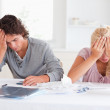 Sad couple while accounting — Stock Photo