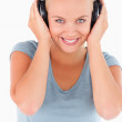 Close up of a cute woman with headphones — Stock Photo #11184447