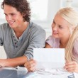 Stockfoto: Happy couple doing paperwork