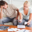 Foto de Stock  : Stressed couple calculating their expenses