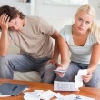 Stock Photo: Worried couple calculating their expenses