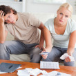 Stock Photo: Worried couple calculating expenses