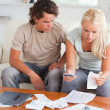 Shocked couple calculating their expenses — Stock Photo #11184813