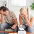 Calculating couple on sofa — Stock Photo #11184819