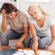 Despaired worn out couple calculating their expenses — Stock Photo #11184830